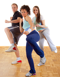 Three young people fitness exercising, kicking